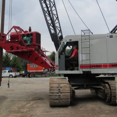 Crane with Auger Attachment